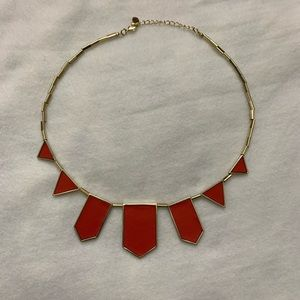 Circular metal orange and gold necklace